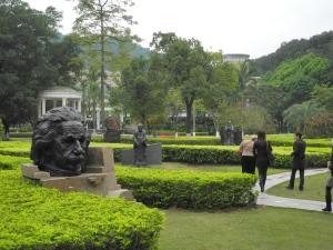 Lawn with sculptures of famous people in front of library