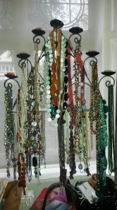necklaces on a candelabra